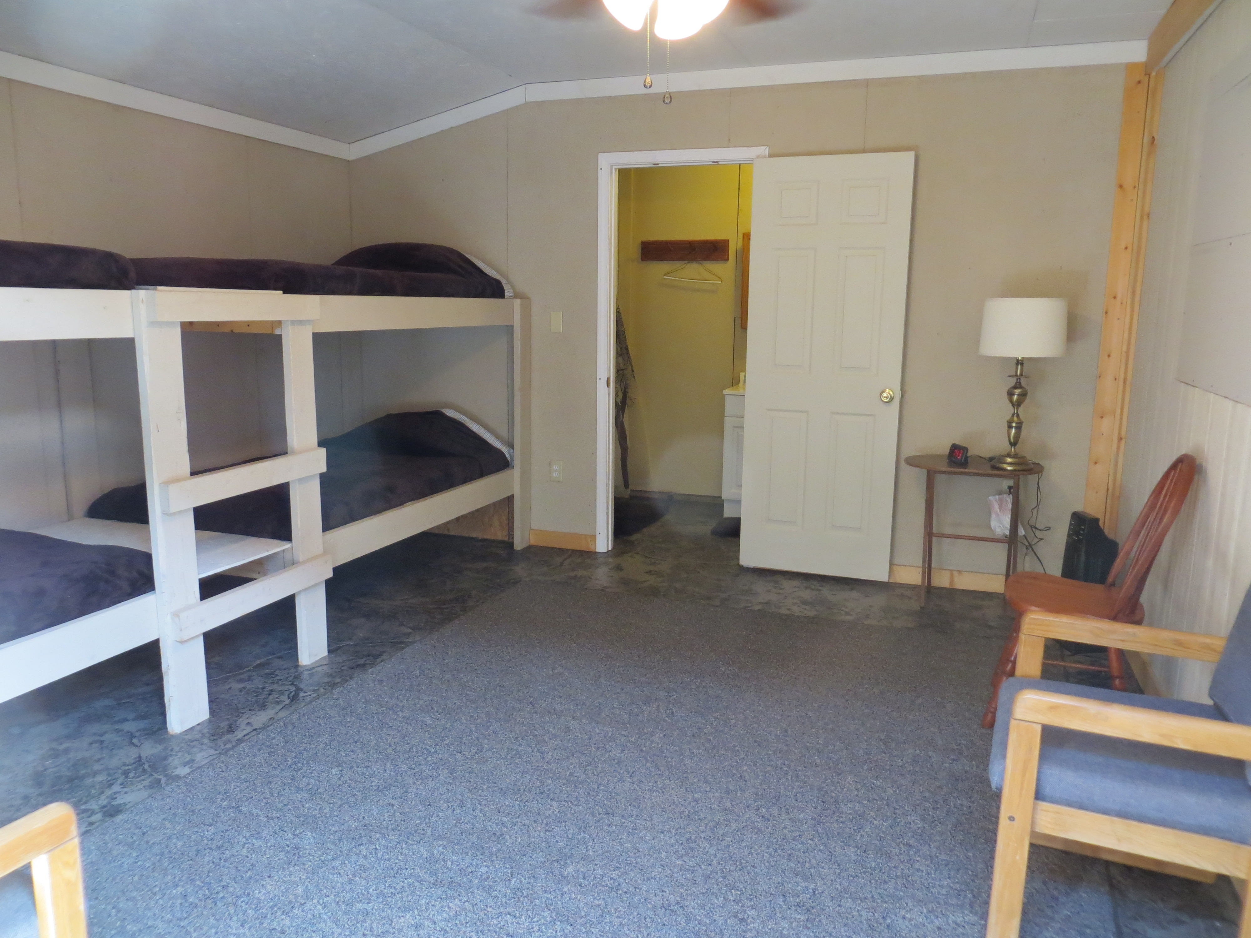 North bunkhouse with 2 sets of bunk beds and a full bath.
